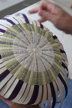 """Passamaquoddy basketmaker Jeremy Frey weaves the bottom of an ash basket Tuesday at his studio in the Indian Township of Princeton. Frey was recognized nationally at the Santa Fe Indian Market in August when he won """"Best of Show."""""""