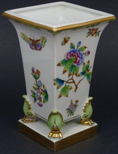 Beatiful Hungarian porcealin vase by the Herend company. Has a square shape with scrolled beast feet and hand painted Chinoiserie floral and butterfly design throughout the body.