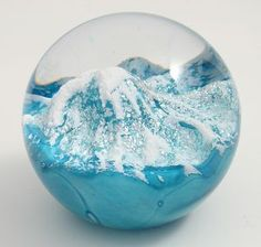Glacier Paperweight  GLASS EYE STUDIO  $120.00   Even a scene as cold as ice can melt your gaze when portrayed in solid glass by the artists at Glass Eye Studio. Handcrafted in the U.S.A.     3 inch diameter  Signed and dated