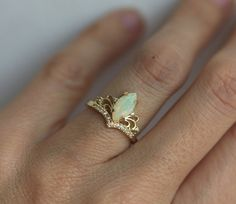 Beautiful vintage inspired opal and diamond ring. Avaliable in 14 and 18k gold, platinum. Other stones are also available: morganite, pearl, turquoise, diamond, rose cut diamond, black diamond, aquamarine and many more. Please contact us for the pricing info. Please choose ring size and metal at the drop down menu. Larger sizes than 8 available upon request.  Product info:  - 14k/18k solid  - main stone welo opal 10 x 5mm, stone size can be customized, larger stones available  - diamonds...