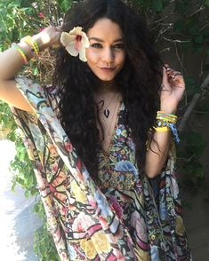 Vanessa Hudgens stunned in a colorful patterned dress, adding layers of jewelry and bracelets to her festival look - paired with her now-infamous Coachella manicure that took an alleged three hours to complete Coachella 2016, Festival Coachella, Coachella Hair, Coachella Style, Street Style Vanessa Hudgens, Vanessa Hudgens Coachella, Celebrity Beauty, Celebrity Style, Festival Berlin