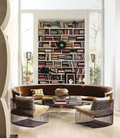 Here's another exquisite living room with books and bookshelves playing a major part in the design.  Just four visible pieces of furniture and what a statement they make.