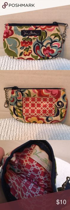 Vera Bradley coin Pre owned Vera Bradley coin purse with an ID holder. This is in good condition. This might need a little cleaning. I don't know how to clean them so I rather just buy a new one. I don't know the name of the design and to tell you the truth I'm actually to lazy to look it up 😂. Pet and smoke free house. Vera Bradley Bags Clutches & Wristlets