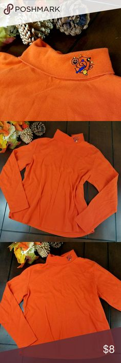 Halloween Embroidered LongsleeveTurtleneck Halloween Embroidered Longsleeve turtleneck available preloved in size L. There are no holes, no tears, and no stains. Features super cute jackolantern and candy embroidery. 100% Cotton. machine washable. Orange. Holiday Editions Tops Tees - Long Sleeve
