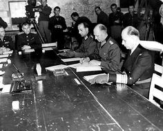 May 7, 1945, American Signal Corps cameramen fillm  history. The Defeat of German Nazi Forces. This photo was taken in the War Room of the Allied Supreme Headquarters. On General Jodl's left is General Admiral Von Friedenburg of the German Navy, and on his right is Major Wilhelm Oxenius of the German general staff.