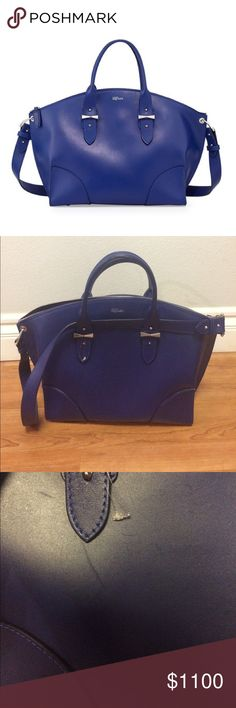 ALEXANDER MCQUEEN Legend Satchel Bag Alexander McQueen Legend satchel bag in a gorgeous cobalt blue calfskin. Although unworn, there are a few subtle scuffs that can be buffed out - bought at a Neiman Marcus sale for $1310; it's now unavailable online! Silver-toned hardware (studs, buckles, etc.) with a sturdy top handle and flat shoulder strap. Canvas lining with one zippered and two open pockets. Reinforced corners make this a beautiful but tough and lightweight bag that'll make any…