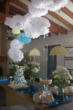 Rain shower themed baby shower. Tissue paper puffs and raindrops/umbrellas cut out on the cricut...