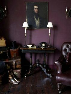 Dark purple aubergine room with leather chair - The Sixty Two would look fab with this back drop.