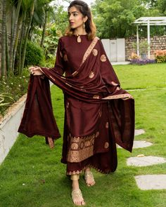 Shop online Maroon and Gold Layered Kurta with Dupatta - Set of Three Maroon hued flared sleeveless inner, with a same coloured outer kurta with golden prints. The outfit is teamed with a matching gold printed dupatta. Silk Kurti Designs, Kurta Designs Women, Kurti Designs Party Wear, Pakistani Dresses Casual, Pakistani Dress Design, Pakistani Clothing, Dress Indian Style, Indian Dresses, Party Wear Dresses