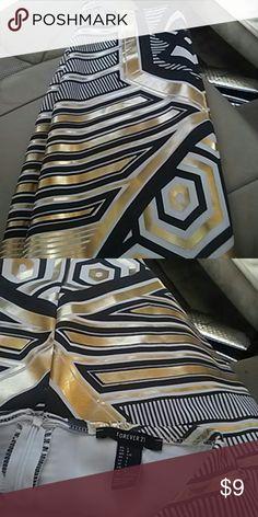 Forever21. Skirt Metalic gold. Black white. Knee. Length skirt.  Worn.  Once. Strechable. Material. Cute. Good. Shape Skirts Mini