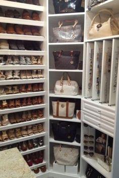 walk in closet-master bathroom , my guest bedroom turn into a walk in closet. Custom closet by closet factory Lighting -Home depot. Wall paper-Home depot Floors- lumb