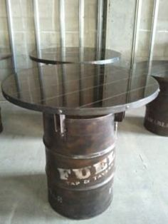 55 gallon fuel drum table barstool height. $475.00, via Etsy.