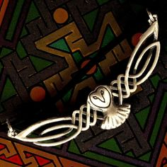 Celtic Owl Pendant in Sterling Silver Traditional Woven Design with Leather Cord CP-119. $37.00, via Etsy.