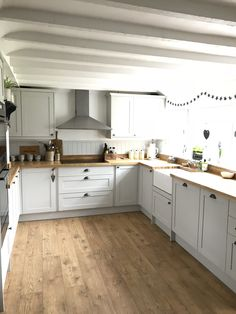oak flooring Thank you to theoldforgecottage for sharing your lovely Allendale Dove Grey Kitchen. The Rustic Oak worktop and Fast-Fit V Groove Tawny Chestnut Oak flooring sets it off beautifully. For more inspiration, visit Howdens. Howdens Kitchens, Grey Kitchens, Modern Farmhouse Kitchens, Home Kitchens, Kitchen Grey, Burford Grey Kitchen, Kitchen With Grey Floor, Grey Kitchen Furniture, Small Kitchen Diner