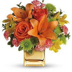 Tropical Punch Bouquet - Glow for it! Capture the magic of a tropical sunset with this gorgeously glowing bouquet. Lush lilies and roses in radiant shades of orange and yellow are presented in a golden Mirrored Cube for a touch of instant glam. Father's Day Flowers, Fast Flowers, Summer Flowers, Wedding Flowers, Fall Flower Arrangements, Romantic Roses, Flowers Online, Exeter, Flower Delivery