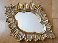 Vintage mirror in Florentine style with golden wood frame