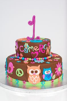 I made this owl cake to match the partywear my husband's cousin (who is like a lil' sis to me) picked out for her daughter's first birthday. Everything but the flowers is freehand, and there are lots of details not shown in this pic, unfortunately. The four owls were the primary elements, with two birds, a butterfly, and lots of flowers, hearts, and peace signs completing the design. Orange dreamsicle cake for the bottom tier and vanilla on the top tier.