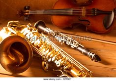 Classic music Sax tenor saxophone violin and clarinet in vintage wood background Stock Photo