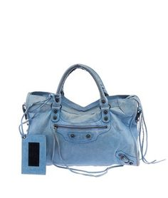 Balenciaga Lake Leather City Motorcycle (26880) Blue Tote Bag. Get one of the hottest styles of the season! The Balenciaga Lake Leather City Motorcycle (26880) Blue Tote Bag is a top 10 member favorite on Tradesy. Save on yours before they're sold out!