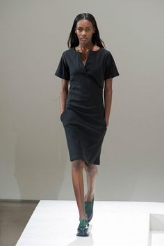Jil Sander A/W '14: little black dresses work best when simple and this one has a notch neckline that makes it interesting