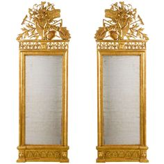 Pair of Neo-classical Italian Pier Mirrors attributed to Giovan Battista Dolci of the renowned North Italian family of sculptors and ebenists, purveyors to the  Duke of Toscany's court during the late 18th Century. They were significant participants in a major 1806 commission of furnishings of similar description for the apartments of Queen of Etruria, Maria Luisa of Bourbon. The only surviving objects from this order are now in the Palazzo Pitti, Florence, Appartementi Reali.