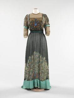 Front Evening dress by Weeks, 1910 Paris, the Met Museum    Associated with royalty and symbolizing beauty, immortality and exoticism, the peacock has long been a favorite motif of artists.