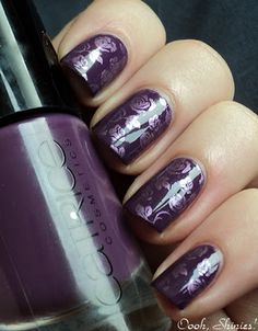 Dark purple nail polish with metalic light purple roses - stamping nail art.