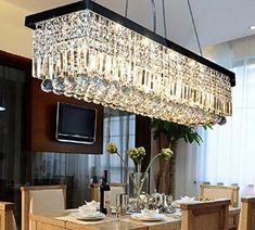 "Reminds me of a Restoration Hardware light but a fraction of the cost. $449  Siljoy L47"" X W10"" X H10"" Clear K9 Rectangle Crystal Modern Chandelier - - Amazon.com"