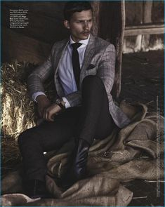Appearing in an editorial for GQ Australia, Nathaniel Visser sports a Hugo Boss tailored look with Paul Smith leather boots, and a Cartier watch.