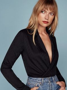 *Wraps self in silk, puts on Frank Ocean* This is an easy fitting wrap top with a v neckline and notched lapel.