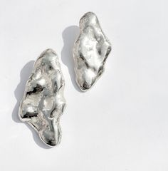 On clouds and silver linings.. Irregular sized pair of Cloudy ear pins☁️ one smaller than the other for a nice asymmetry, in polished sterling silver. By Marina van Dijke www.marinavandijke.com