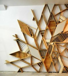 Using old, recycled pieces of wood, connecting them together to create a pattern, but could also be used for shelving. Could work well with the flooring in our location!!