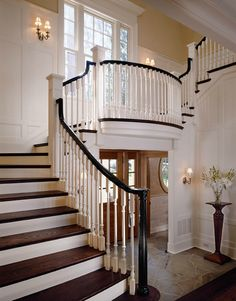 Stairway that gives you an open foyer but still allows the second floor to be positioned over it. The window at the landing could be made a door with an exterior balcony.