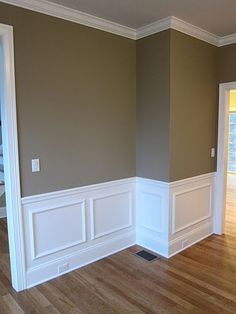 Interior shadow box wall moldings and chair rail trim in a custom dream home.  Pottery Barn wall color with white trim and crown molding  Built by Advantage Contracting in West Hartford, CT.