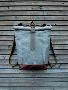 Waxed canvas rucksack / backpack with roll up top and leather