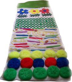 Great example of a total DIY sensory rug by a mother in Russia from a discussion group (deti.mail.ru/forum by Eugene) I love the way she used the dollar store sponges and other simple items to make a sensory experience on the floor- or hang on the wall! Pin by Gail Zahtz