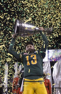 Edmonton Eskimos quarterback Mike Reilly (13) holds the Grey Cup after defeating the Ottawa Redblacks at the 103rd Grey Cup on November 29, 2015 in Winnipeg. Photo by Greg Southam / Edmonton Journal