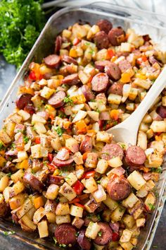 Potato Pepper and Sausage Bake is a hearty and filling side dish full meal or breakfast hash. Comprised of potatoes sausage sweet peppers and onions. Breakfast Hash, Breakfast Potatoes, Breakfast Recipes, Breakfast Casserole, Smoked Sausage Recipes, Baked Sausage, Sausage And Sweet Potato Recipe, Turkey Kielbasa Recipes, Smoked Sausage Hash