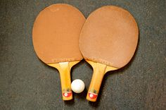 Original vintage set of soviet/finnish wooden ping pong POHJALA paddles, complete with two original ping pong balls. Circa: 1960 - 1970s Used, still in very good original condition, great for ping pong game or collection. Rare.