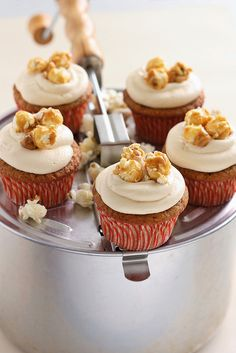 Caramel Corn Cupcakes...So the cake has cream corn puree and corn meal in it and the frosting is caramel flavored.  Umm...yum.