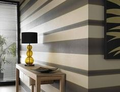 use horizontal stripes to draw you into a room