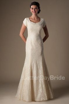 The Chamberlain | This modest wedding gown is sure to be a favorite this season! The soft delicate lace shines with a gentle shimmer in the light on this gorgeous gentle mermaid silhouette with scalloped sleeves and a sweetheart neckline.    Gown available in Gold, Ivory or White    *Gown pictured in Gold     Sleeve length or neckline can be customized.  Please call for more information.    Available at LatterDayBride.com or in Store Located in Salt Lake City, Utah