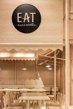 Designers Siriyot Chaiamnuay and Arisara Chaktranon of Thai studio Onion designed the interior of Eat Rice & Noodle, a small 66 sqm restaurant located in Bangkok's EmQuartier shopping hub on Sukhumvit road.