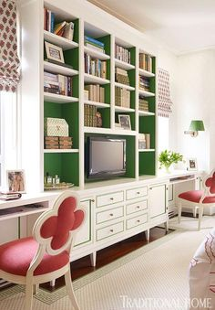 "The ""homework"" end of this girl's bedroom features a wall of built-in bookshelves, the interiors painted green to let the chaos of books stand out - Traditional Home® / Photo: Pieter Estersohn & John Bessler / Design: Celerie Kemble"