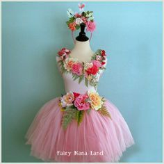 Tie the flower headpiece into the skirt like this - good idea