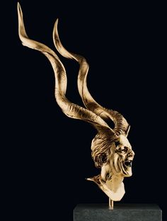 Jan Fabre. I saw some of these sculptures in Europe and they are pretty cool!