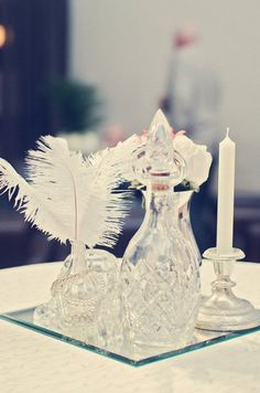 1920s: Glass Decanters and Feathers Photo by Renaissance Studios Photography via Style Me Pretty