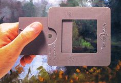 "View Catcher... This artist's view finder is an indispensable tool that should be in everyone's portable easel. Quickly arrange any vertical or horizontal composition using the unique adjustable door, and isolate/analyze colors with the ""peep hole"" in a neutral grey background.  We keep one in every painting box...."