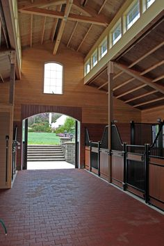 European stalls, rubber pavers, and a nice, high ceiling with windows for natural light Love it!