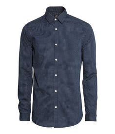 Classic long-sleeved shirt with an easy-iron finish. Turn-down collar. Tailoring darts at back. Slim fit.